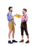 Men in traditional bavarian clothes holding mugs of beer Stock Images