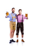 Men in traditional bavarian clothes holding mugs of beer Royalty Free Stock Images