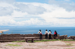 Men in  traditional clothes at Taquile Island at lake Titicaca in Peru Stock Images