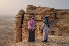 Two Arab men in traditional clothing at the Edge of the World near Riyadh in Saudi Arabia stock image