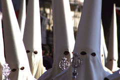 Men in traditional costume, Holy Week Malaga Spain. Good Friday Procession with people in traditional hooded dress, Malaga, Spain Royalty Free Stock Photo