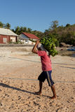 Men transports cargo from ship Stock Photos