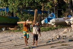 Men transports cargo from ship to shipyard Stock Image