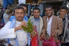 Men try khat (Catha edulis) at the local market in Lahij, Yemen Royalty Free Stock Image