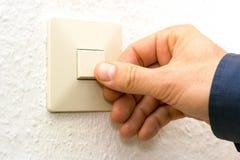 Men turning on light switch. Men turning on white light switch stock images