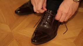 Men Tying his Shoes Lace Up stock footage