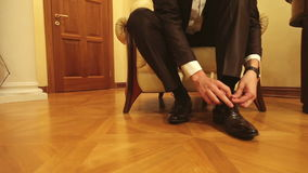 Men Tying his Shoes Lace Up stock video
