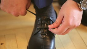 Men Tying his Shoes Lace Up stock video footage