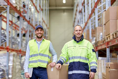 Men in uniform with boxes at warehouse Royalty Free Stock Photo