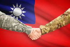 Men in uniform shaking hands with flag on background - Taiwan Stock Images
