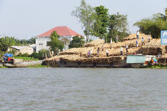 Men unload timber Royalty Free Stock Photos