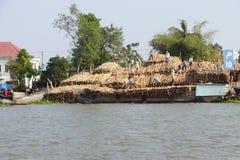 Men unload timber Stock Image