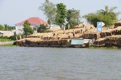 Men unload timber Stock Photos