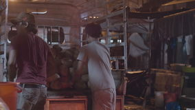 Men unload a truck. With coconuts stock video footage