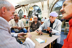 Men at the Urfa bazaar in Turkey. Kurdish and Arabic men play a game of dominos in the cay(tea) garden inside the Urfa Bazaar in Urfa (Sanliurfa) in eastern Royalty Free Stock Photo