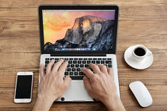 Men use Apple MacBook Pro Royalty Free Stock Photo