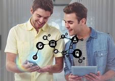 Men using digital table and smart phone with connecting icon. Digital composition of men using digital table and smart phone with connecting icon Royalty Free Stock Photo