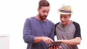 Men using a digital tablet. On a sunny day stock footage