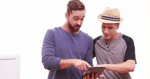 Men using a digital tablet stock video