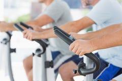 Men using exercise bikes Royalty Free Stock Images