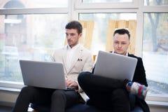 Men using laptops Royalty Free Stock Image