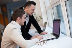 Men using laptops. In startup center stock photo