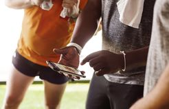 Men using mobile phone during work out Stock Photos