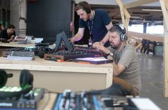 Men using music synthesizer mixing system at sonar festival. Musicians play and test mixing and composing sound systems during Sonar advanced technology music Royalty Free Stock Images