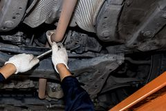 Men are using a screwdriver and a car repair wrench open oil royalty free stock photos