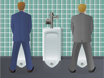 Men Using Urinal Stock Image