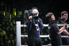 Men videographers will broadcast live from ring Royalty Free Stock Photo