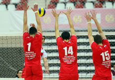 Men volleyball players try to block an attack Stock Photo