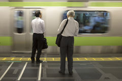 Men wainting for train in Japan Royalty Free Stock Image
