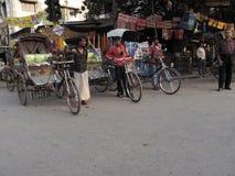 Men wait for passengers on their rickshaw in Kolkata Royalty Free Stock Image