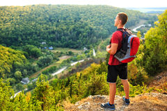 Men walk along the hill with backpack Royalty Free Stock Photos