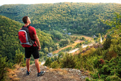 Men walk along the hill with backpack Stock Photos