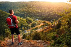 Men walk along the hill with backpack Stock Photography