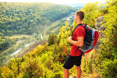 Men walk along the hill with backpack Stock Images