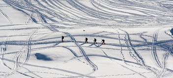Men walk on snow Stock Photography