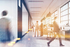 Men walking in business center lobby. Men are walking in a corridor of a business center. There are conference rooms with glass walls. 3d rendering. Mock up Royalty Free Stock Photo