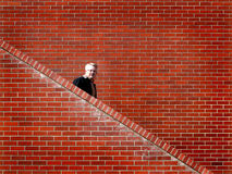 Men Walking down Stairs Brick Wall Stock Photos