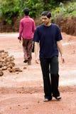 Men walking opposite direction Stock Images