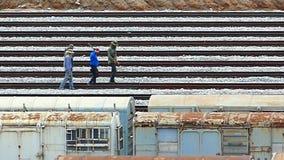 Men walking on railroad tracks. stock footage