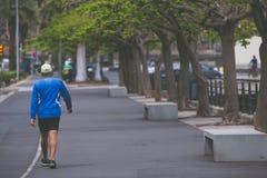 Men walking in sports wear on promenade. Photography in vintage style Stock Image
