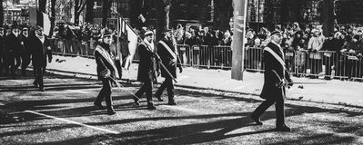 Men Walking on Streets Carrying Flag during Parade In Grayscale Photo Stock Photos