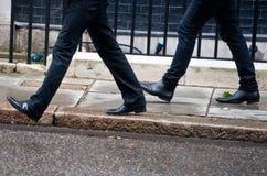 Men Walking Together Stock Photo