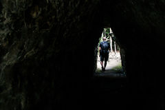 Men walking tunnel Coba Mayan Ruins in Mexico Yucatan Royalty Free Stock Image