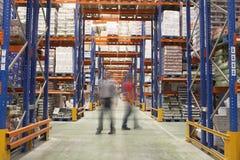 Men Walking In Warehouse Royalty Free Stock Photos