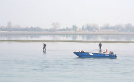 Men walking on water Royalty Free Stock Images