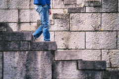 Men walks alone down the stone stairs Stock Photography